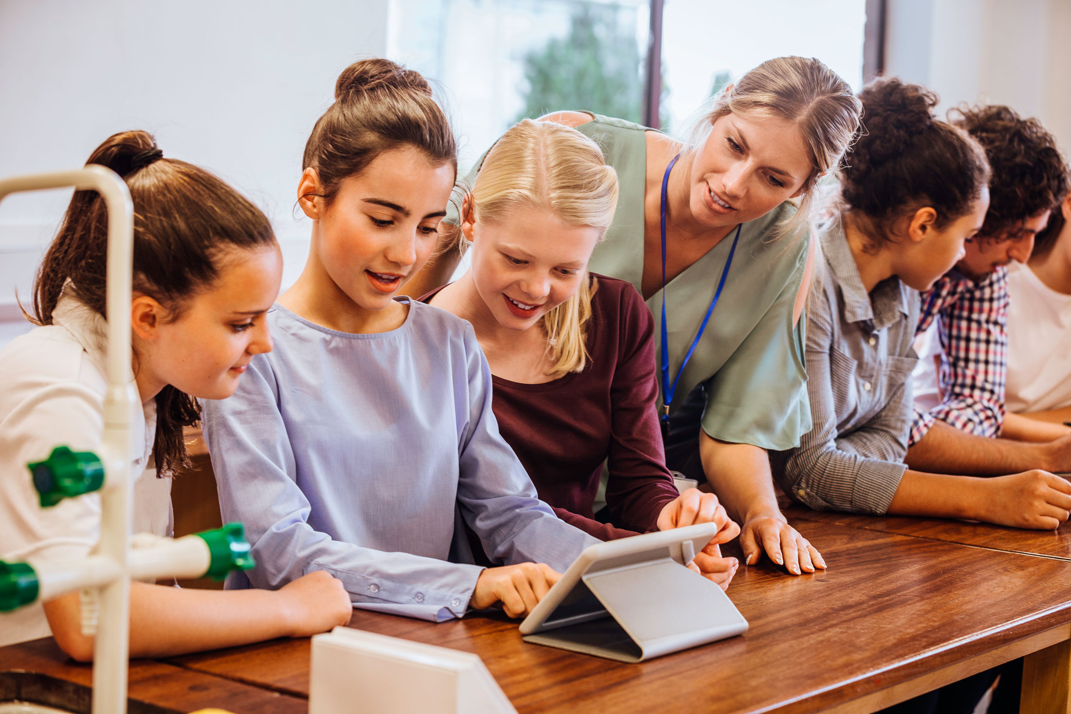 group-kids-science-classroom-using-tablet